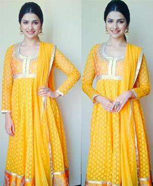 Prachi Desai in a yellow coloured long Anarkali Suit by Designer Anita Dongre