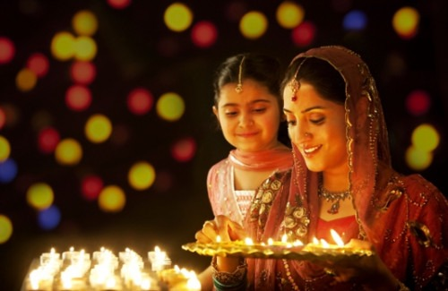 mother-and-daughter-lighting-candles-strand-of-silk-The Diwali Festival: A Celebration of Lights
