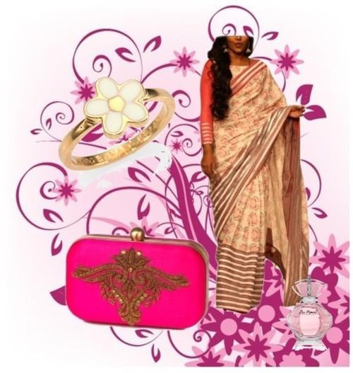 Indian Designer Sharavan Kumars printed saree and Accessory Designer Karieshma Sarnaa's bright pink clutch