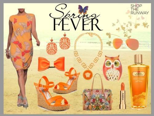 Indian Fashion Designer Rajesh Pratap Singh presents a beautiful orange dress