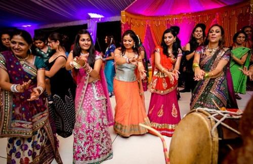 women-dancing-at-an-Indian-wedding--strand-of-silk-gettin' jiggy-with-it-indian-wedding-dances