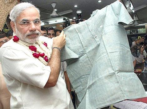 Prime Minister Narendra Modi looking at khadi clothes at a store