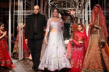 What Designers think about New Indian Brides' Preferences | Tarun Tahiliani and a Model at India Bridal fashion Week 2013