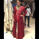 Backstage at a Manish Malhotra Show Checking Out a Red Saree