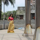 Behind the Scenes at a Priti Sahni Photoshoot featuring a Red Blouse and a Yellow Skirt Lehenga