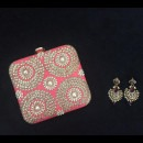 A Coral Coloured Clutch by Purple Sack Matched with Traditional Earrings