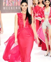 Nargis Fakhri on the ramp in a stylish red dress