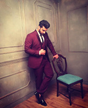 Arjun Kapoor looking dapper in a red coloured suit