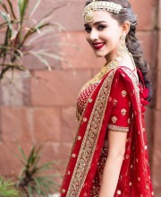 Pranvarin in a traditional red coloured Indian bridal saree by Sabyasachi in Thailand