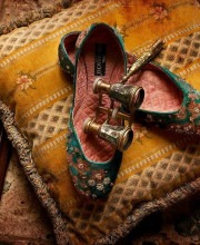 Embroidered green coloured traditional Indian shoes or Mochadi's featured in Sabyasachi's Palermo Afternoons campaign