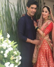Urila Matondkar in a Red Lehenga by and with Manish Malhotra